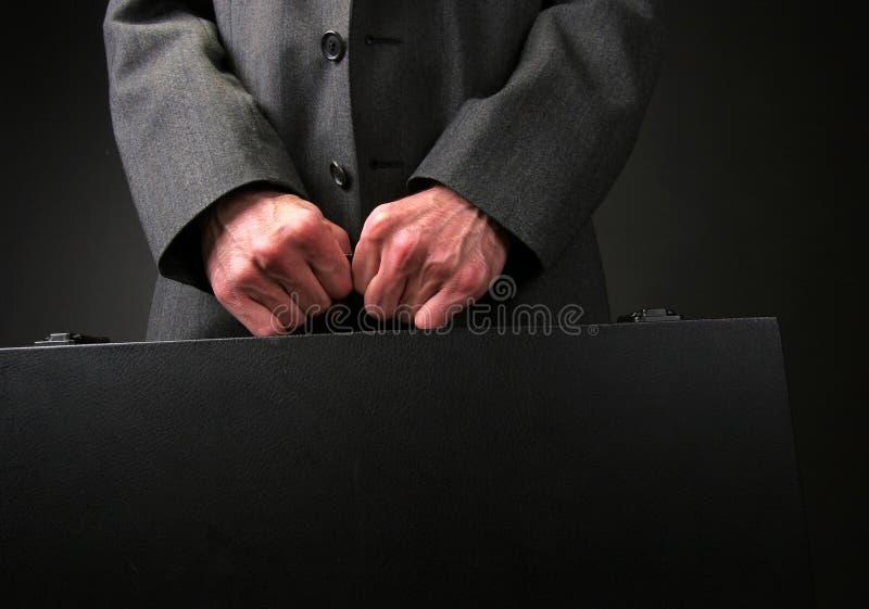 Geschäftsmannaktenkoffer stockbilder