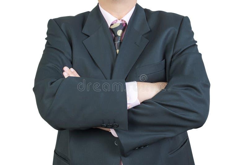 Geschäftsmannarme gekreuzt stockfotografie