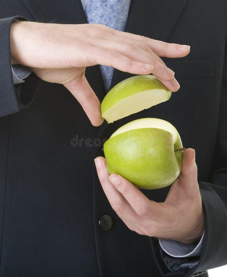 Geschäftsmannerscheinenprozente des Apfels stockfotos