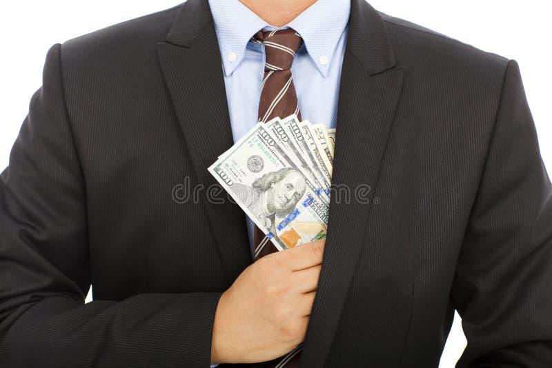 Geschäftsmannfellgeld in der Tasche mit weißem Hintergrund stockfotografie