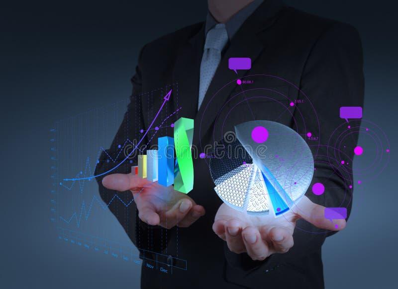 Geschäftsmannhand hält Diagrammstangen- und -tortenwachstum stockbild