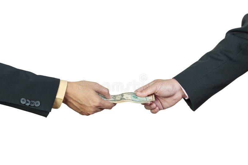 Geschäftsmannhand und -geld zu anderem stockfoto