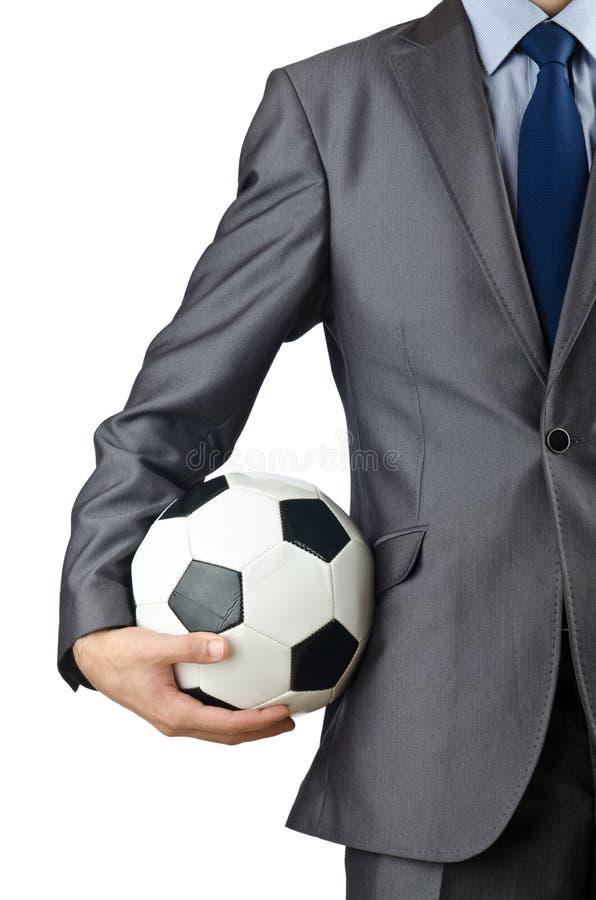 Geschäftsmannholdingfußball lizenzfreie stockbilder