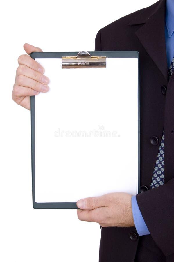 Geschäftsmannholdingklemmbrett lizenzfreie stockbilder