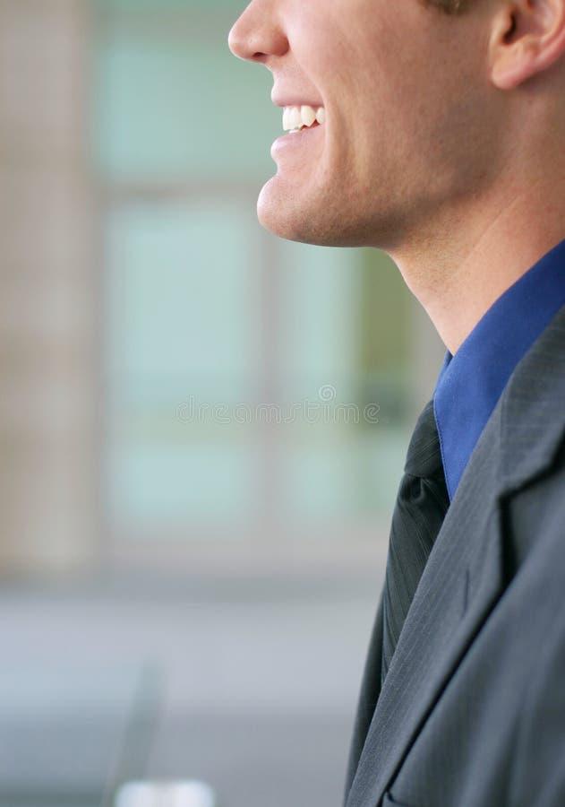 Geschäftsmannlächeln lizenzfreie stockfotos