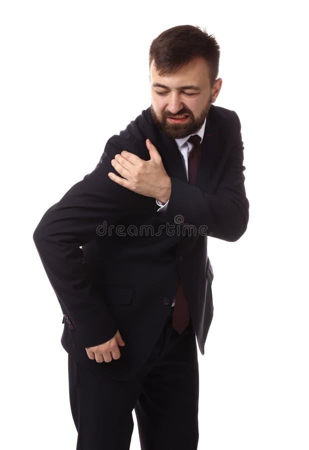 Geschäftsmannleiden von den Schmerz in der Schulter auf weißem Hintergrund stockfoto