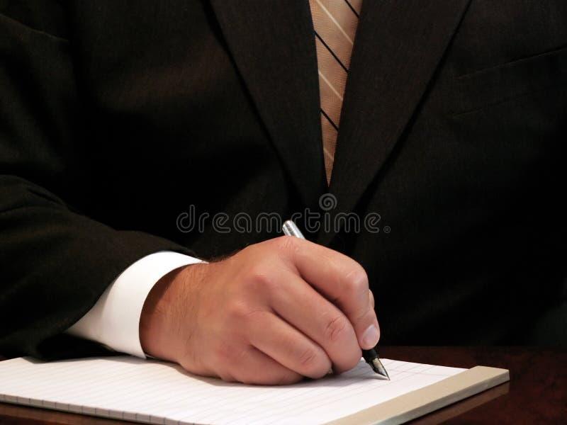 Geschäftsmannschreiben lizenzfreie stockfotografie