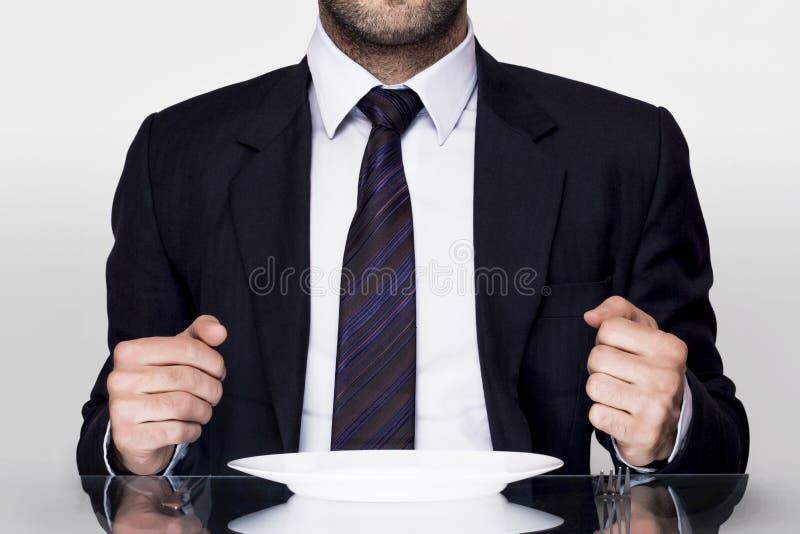 Geschäftsmannspeisen stockfoto