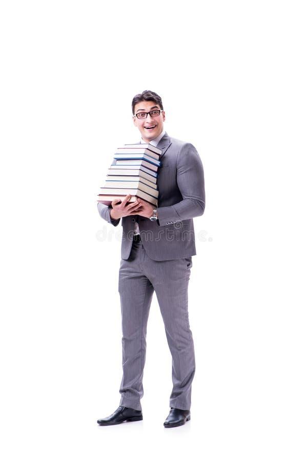 Geschäftsmannstudent, der Stapel von den Büchern halten lokalisiert auf w trägt stockfotos