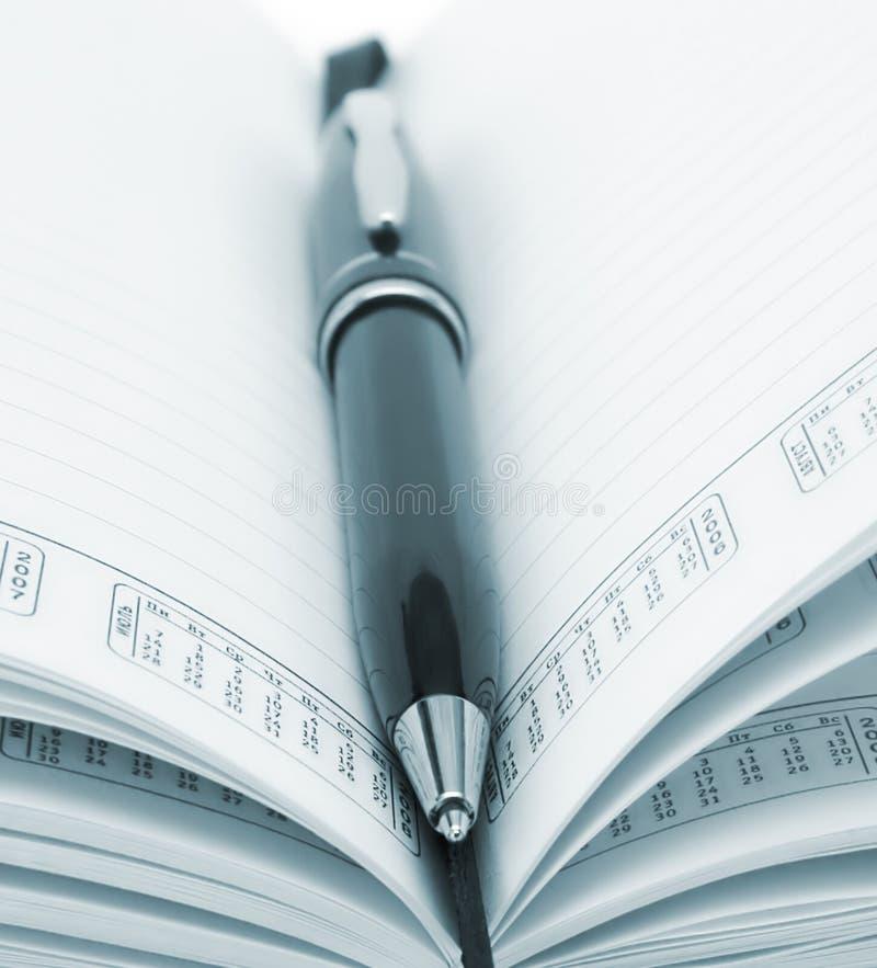 Geschäftsnotizbuch lizenzfreie stockfotos