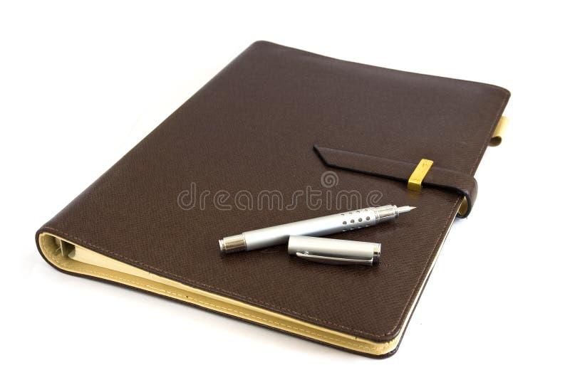 Geschäftsorganisator mit silberner Feder stockfoto