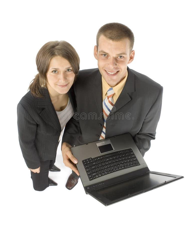 Geschäftspaare mit Laptop stockfotos