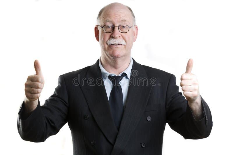 Geschäftsperson, die Daumen aufgibt stockbild