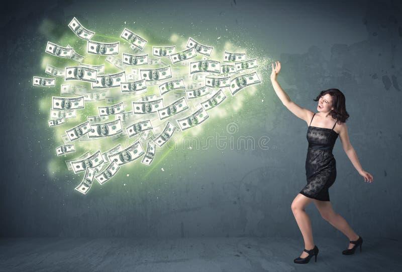 Geschäftsperson, die viel Dollarscheinkonzept wirft stockbild