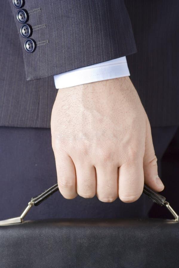 Geschäftsperson mit einem Koffer stockfotos