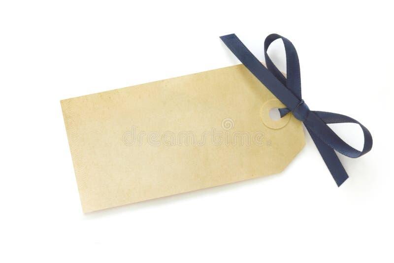 Geschenk-Marke mit blauem Bogen lizenzfreie stockbilder