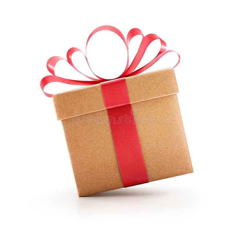 Geschenkbox mit dem roten Bogen lokalisiert stockbilder