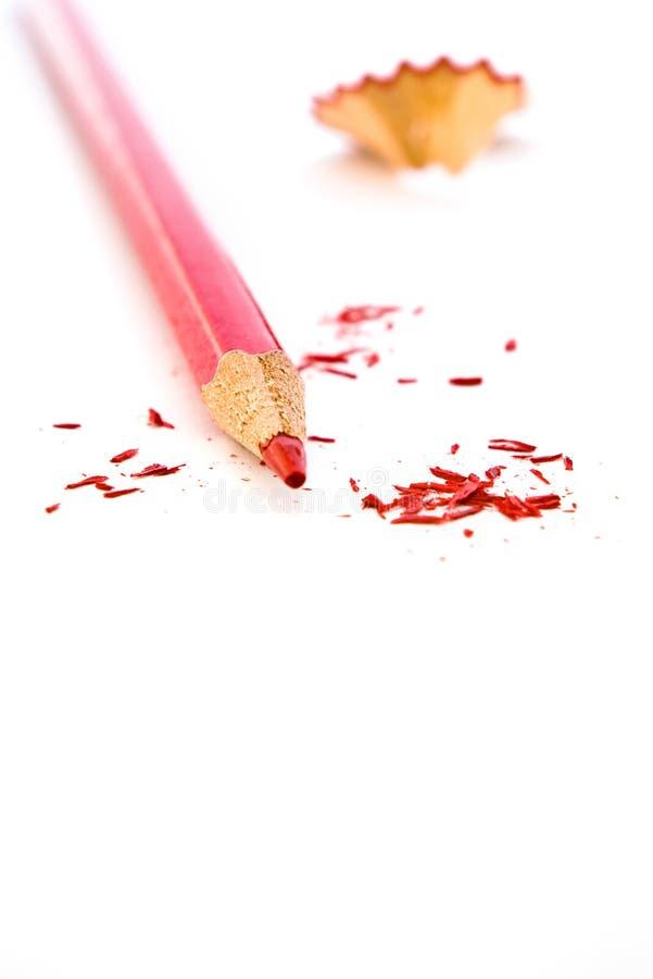 Gescherpt rood potlood stock foto's