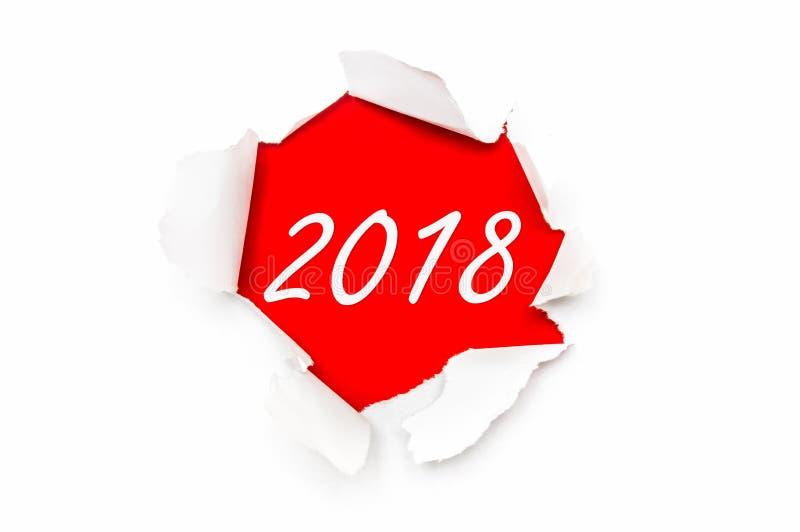 Gescheurd document met geschreven woordennieuwjaar 2018 stock afbeelding