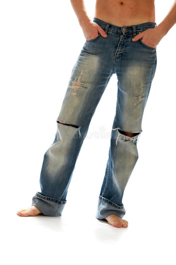 Gescheurde jeans stock foto