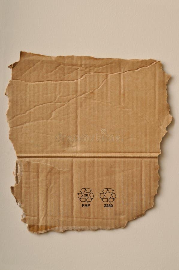 Gescheurde karton en symbolen royalty-vrije stock afbeeldingen