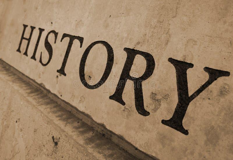 Geschiedenis die in steen wordt gesneden stock foto's