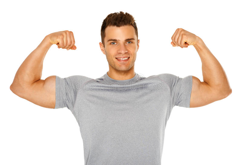 Geschikte en spiermens die zijn bicepsen op wit buigen royalty-vrije stock afbeelding