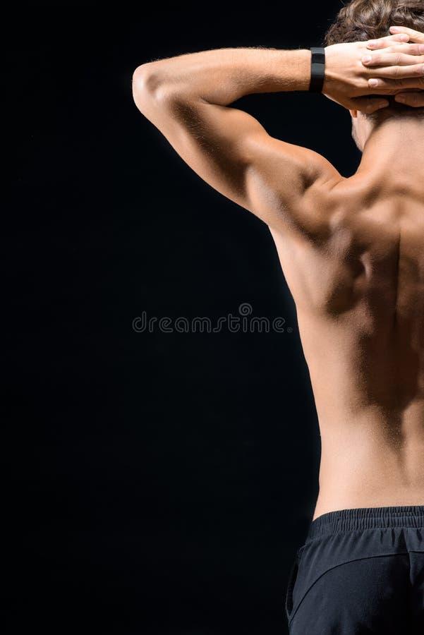 Geschikte mens die zijn opgeleid lichaam tonen stock afbeeldingen