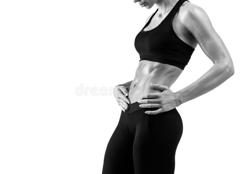Geschiktheids sportieve vrouw die haar tonen goed - opgeleid lichaam royalty-vrije stock foto