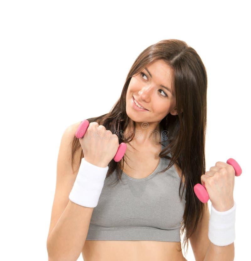 Geschiktheidsvrouw met perfecte atletische lichaam en abs training stock foto
