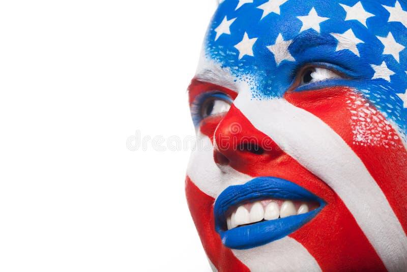 Geschilderd vrouwengezicht. stock fotografie