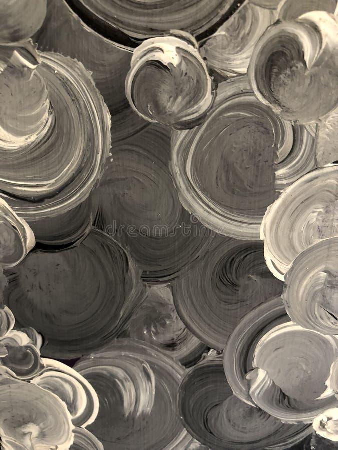 Geschilderde cirkels in grijs en zwart stock afbeeldingen