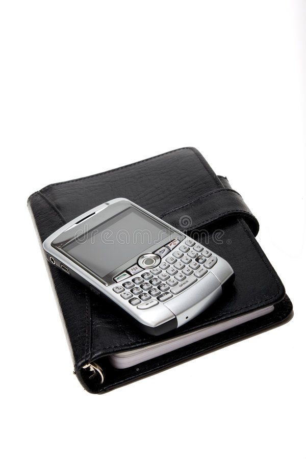 Geschlossener Planer mit PDA lizenzfreie stockbilder