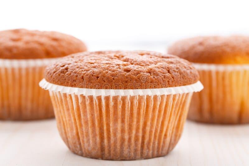 Geschmackvolle Muffinkuchen stockfotos