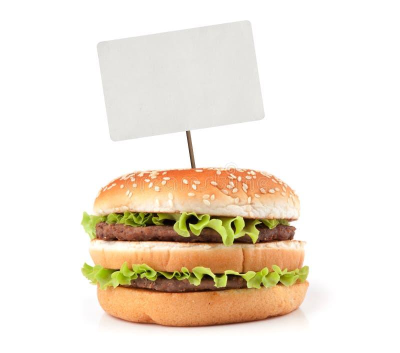 Geschmackvoller großer Hamburger mit Preis stockbild
