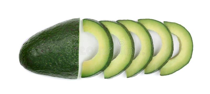 Geschnittene Avocado lokalisiert auf weißer Hintergrundnahaufnahme Beschneidungspfad eingeschlossen stockbild