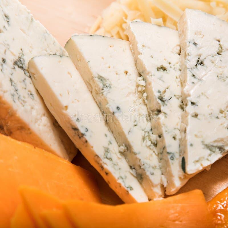 Geschnittene Käse und Pizza stockfotografie
