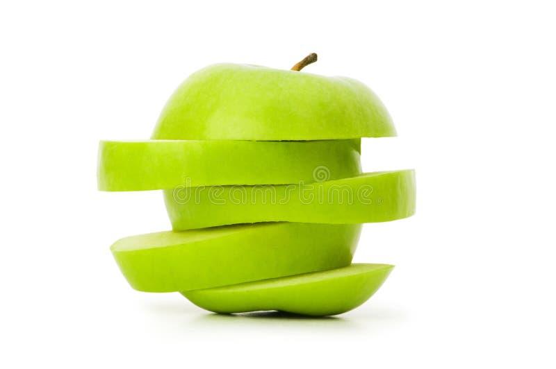 Geschnittener grüner Apfel getrennt stockbilder