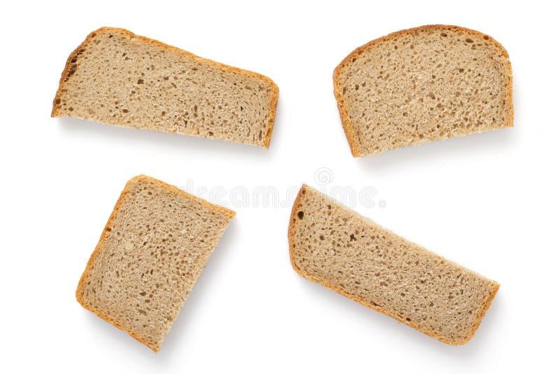 Geschnittenes Brot getrennt auf Weiß lizenzfreies stockfoto