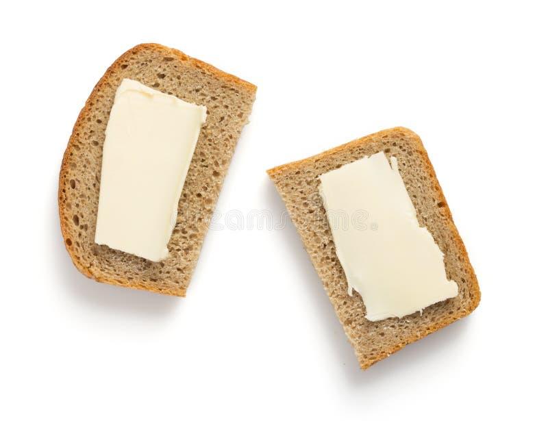 Geschnittenes Brot getrennt auf Weiß stockfotografie