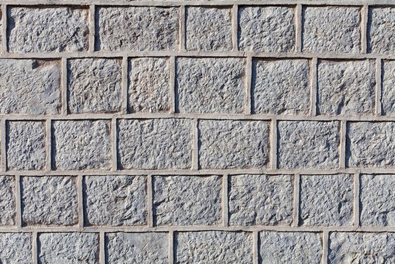 Geschnitzte Steinblöcke oder Ziegelsteine Oberflächen mit Zementbewurf stockfotografie