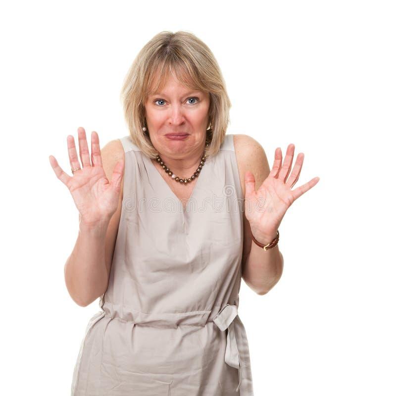 Geschokte Vrouw die Handen steunt royalty-vrije stock afbeelding