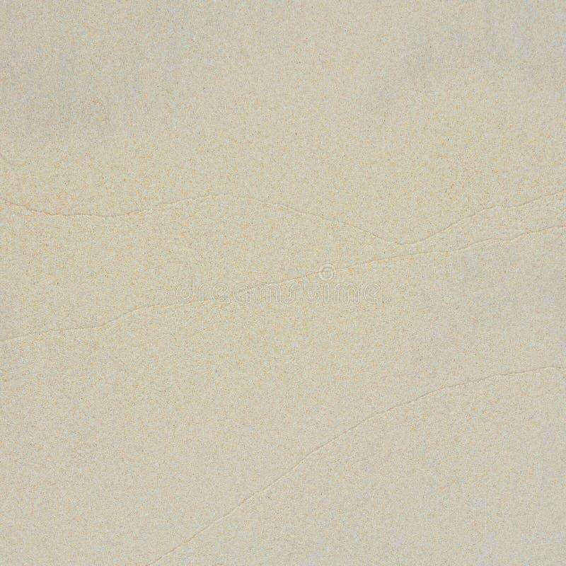geschossen vom Sand auf den Strand Nahaufnahme des groben Sandes lizenzfreie stockfotos