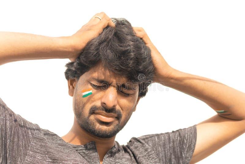 Geschotene de close-up, de Droevige uitdrukking van de Mannelijke Indische ventilator van de Veenmolsport met geschilderde Indisc royalty-vrije stock foto