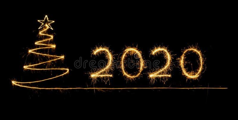 2020 geschreven met Fonkelingsvuurwerk royalty-vrije stock afbeeldingen