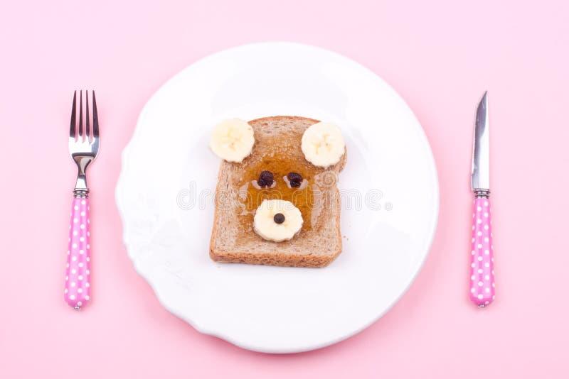 Gesicht auf Brot zum Frühstück lizenzfreies stockbild