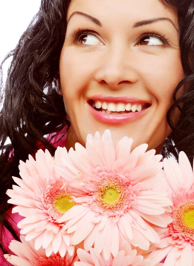Gesicht der jungen Frau mit Blumen lizenzfreie stockfotos