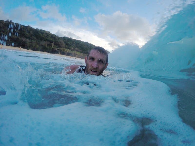 Gesicht in der Welle stockbild