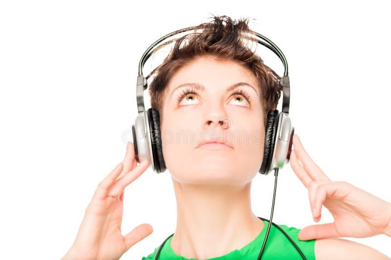 Gesicht eines jungen Mädchens, das Ihre Lieblingsmusik genießt lizenzfreies stockfoto