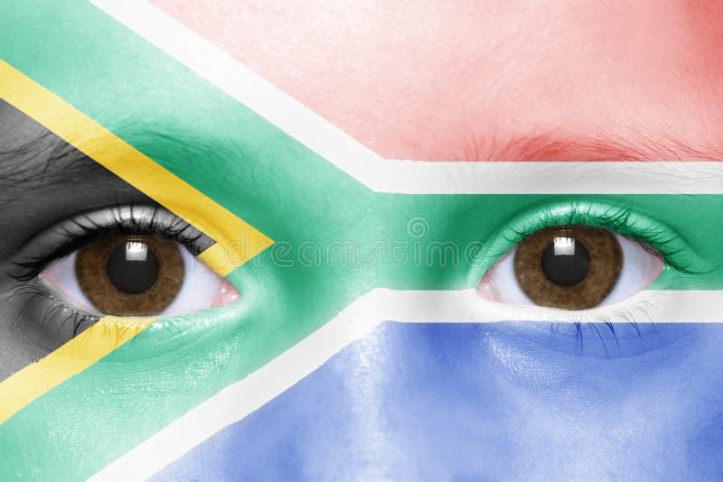 Gesicht mit Südafrika-Flagge stockfotos